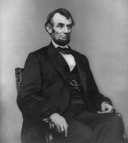 534px-Abraham_Lincoln_seated,_Feb_9,_1864